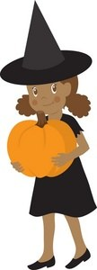 Child dressed as a witch holding a pumpkin